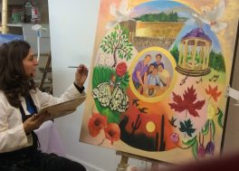 Sima beside her painting